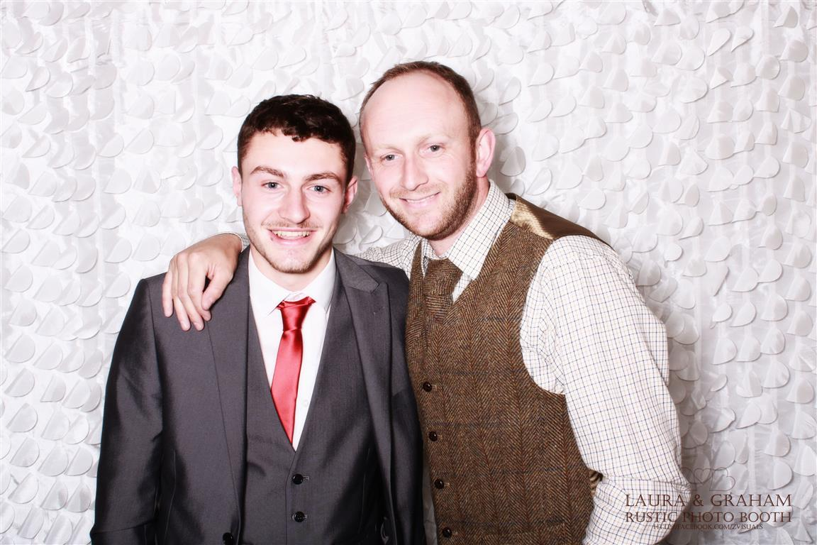 two men in the photo booth
