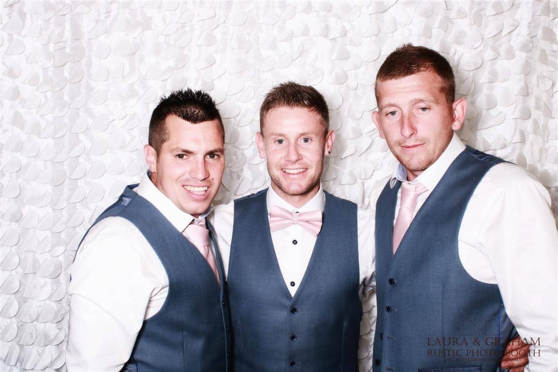 three men in the photo booth